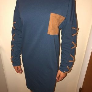 Blue long sleeve dress with brown pocket